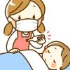 熱を測る保育士